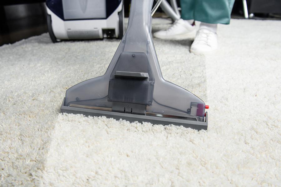 man cleans the carpet