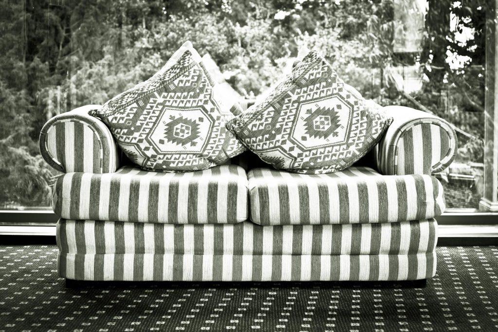 black and white colored sofa