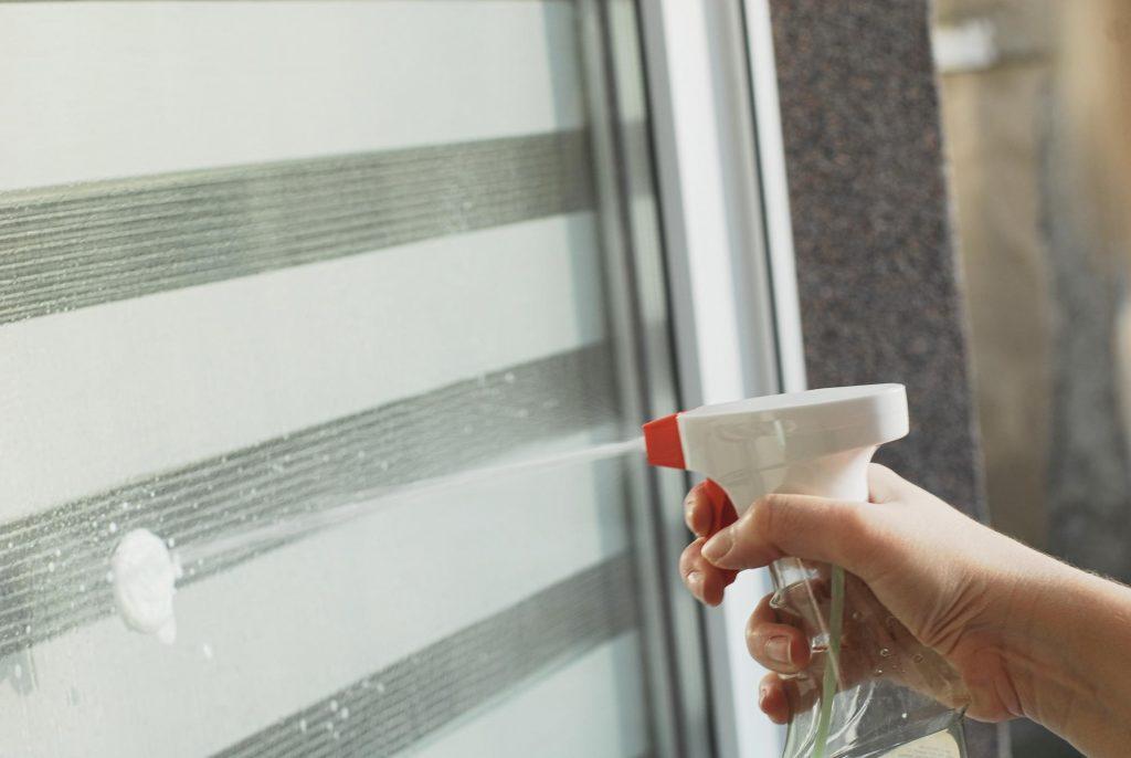 lady sprays the window